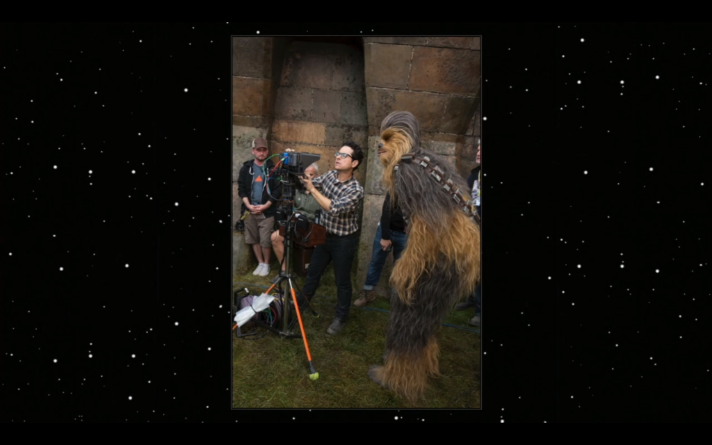 J.J. Abrams poses with Chewbacca on set.