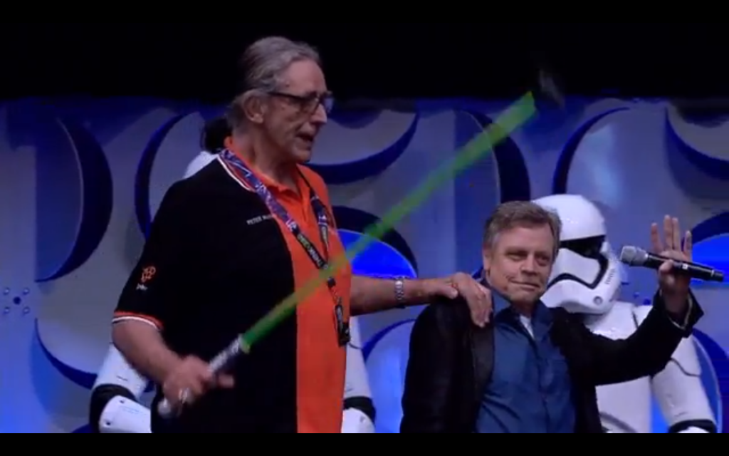 Peter Mayhew (Chewbacca) hobbles onstage with a lightsaber cane!